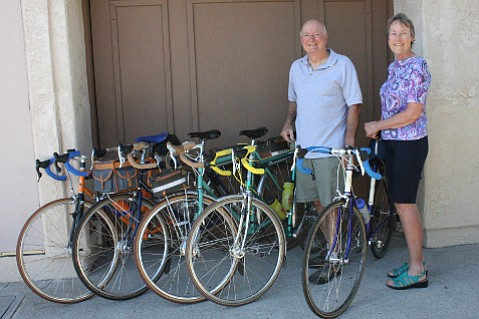 Wilson and Gail Hubbell pose alongside a few of their favorite bikes.