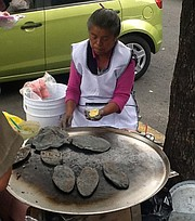 The tlacoyo, a midnight-blue, torpedo-shaped patty.