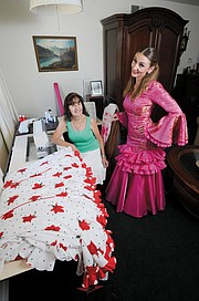 """HOBBY BECOMES HABIT:  Pat Dunselman (above, seated) is a former schoolteacher who makes dresses at her home in Goleta for her granddaughter, Anastasia Maria Sagawinia, and others. """"I sit and sew and put on old movies,"""" said Dunselman. """"It's so many hours, so much detail."""""""