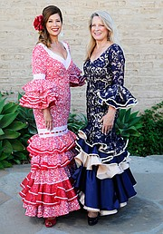 """NOT JUST FOR GIRLS:  Even the boardmembers of Old Spanish Days, including Primera Vice President Rhonda Ledson Henderson (left) and Segunda Vice Presidente Denise Sanford, get dresses handmade for the citywide party. """"The fact that any of these seamstresses have the time, energy, and material left to help dress our board in traditional flamenco attire—after the thousands of dancers they dress—that is pretty much heroic in my opinion,"""" said Henderson."""