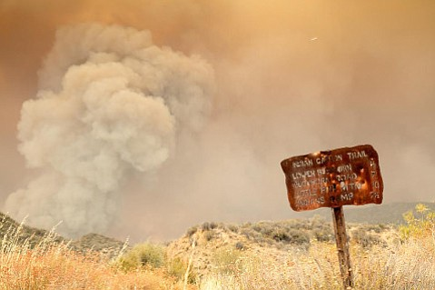 On Monday, the Rey Fire burned along Indian Creek as shifting winds kept it out of the Mono watershed. The view here is from the Indian Creek trailhead looking toward the fire as it is poised to cross over and head uphill toward the Mono drainage.