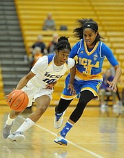 <b>TAKING IT TO THE BRUINS:</b>  UCSB guard Onome Jemerigbe (#10) crosses midcourt under pressure from UCLA All-American Jordin Canada