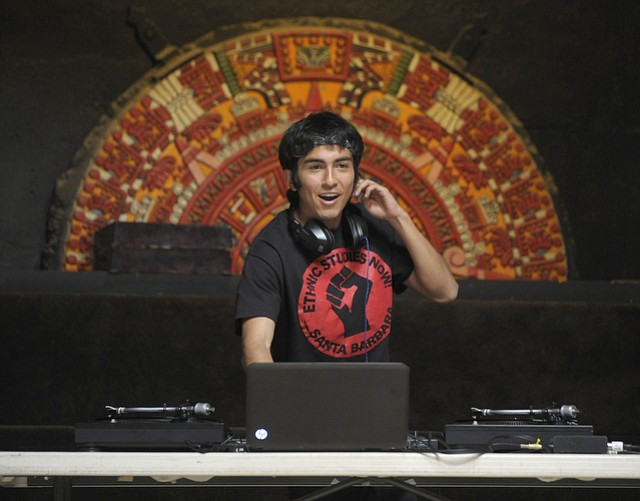 "DJ Javier ""Serenade"" Aguilar sets up his turntables at Casa de la Raza"