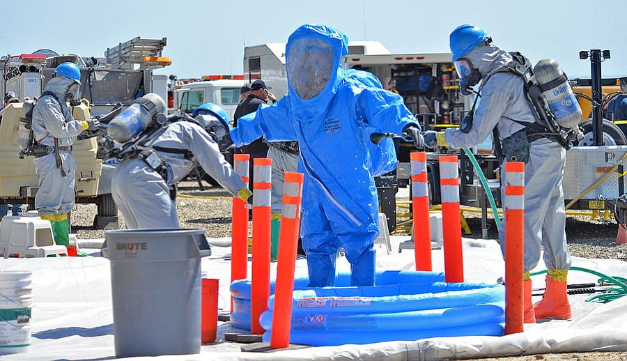 HAZ-MAT DRILL -  Hazardous Materials Team Members decon other firefighters after they left the railcar involved in the drill held in Gaviota.