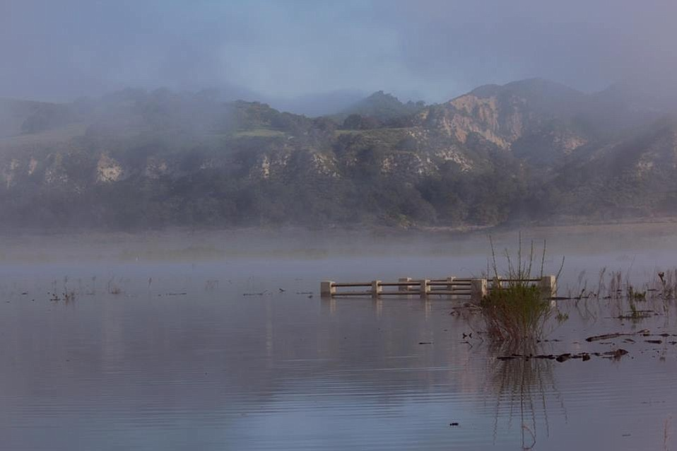As Cachuma Lake rises, landmarks including the old bridge become submerged once again.