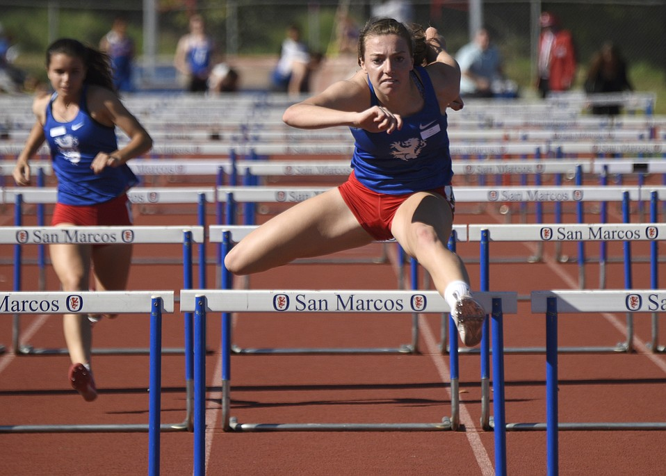 San Marcos hurdler Allie Jones (above, foreground) and 800-meter standout Erica Schroeder (below) set new records at the Santa Barbara County Championships.