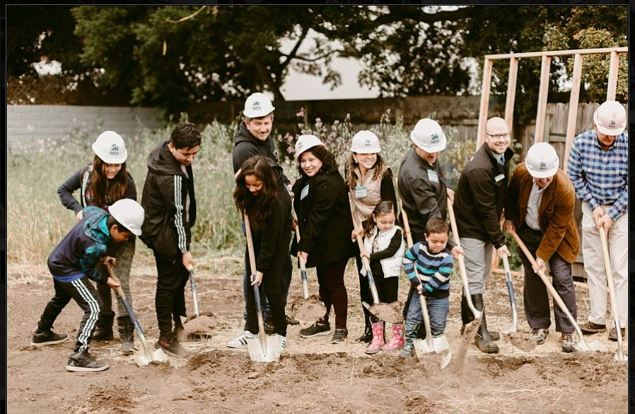 New householders and officials were all smiles at the groundbreaking for Habitat for Humanity's site in Carpinteria.