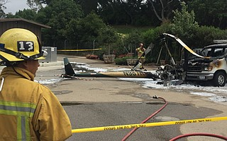 An R44 Robinson helicopter made an emergency landing at La Cumbre Country Club. Pilot and three passengers walked away, but an ensuing fire burned the aircraft and two parked vehicles just 10 feet from a fueling station.