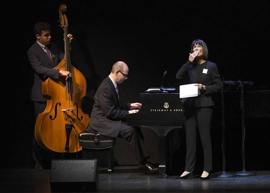 L to R Zachary Lewis Towbes (bass), Scott Hiltzik (piano) and Anne Towbes (vocals) perform at a memorial Celebrating the Life of Michael Towbes at the Granada Theatre (May 23, 2017)