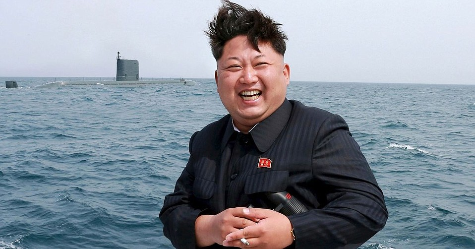 North Korean leader Kim Jong Un celebrates with a smoke after the successful test flight of a submarine-launched ballistic missile.