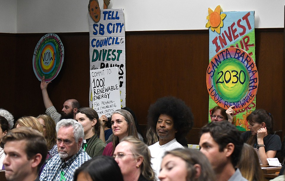 Tuesday's City Council meeting was so packed with people upset by President Trump's withdrawal from the Paris climate-change accord that city cops had to divert members of the public to overflow chambers.