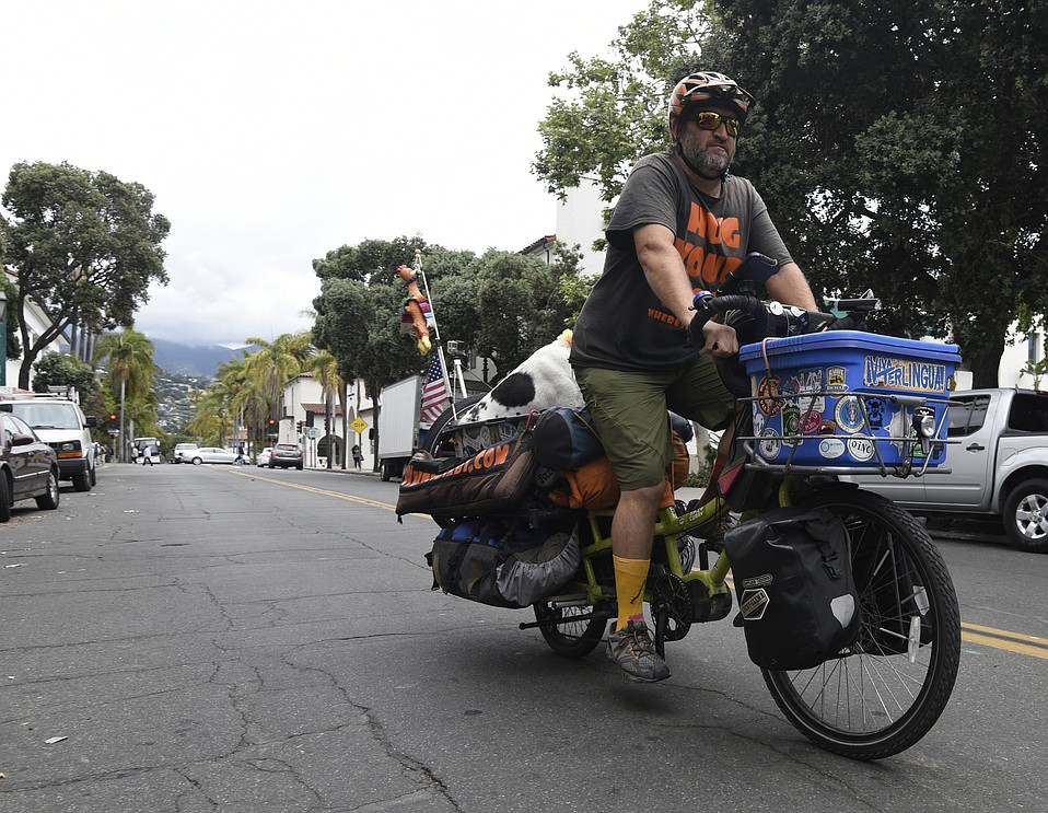 Mike Minnick and Bixby passing through Santa Barbara on an electric assist Yuba cargo bike.