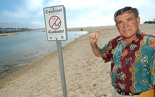 Tony Romasanta, pictured here in 2004, found himself at the center of the dispute over containing Mission Creek, which emptied into the ocean by Romasanta's beachfront hotel.