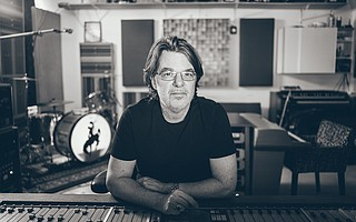 Eric Ambel behind the board at his recording studio, Cowboy Technical Services in Brooklyn.