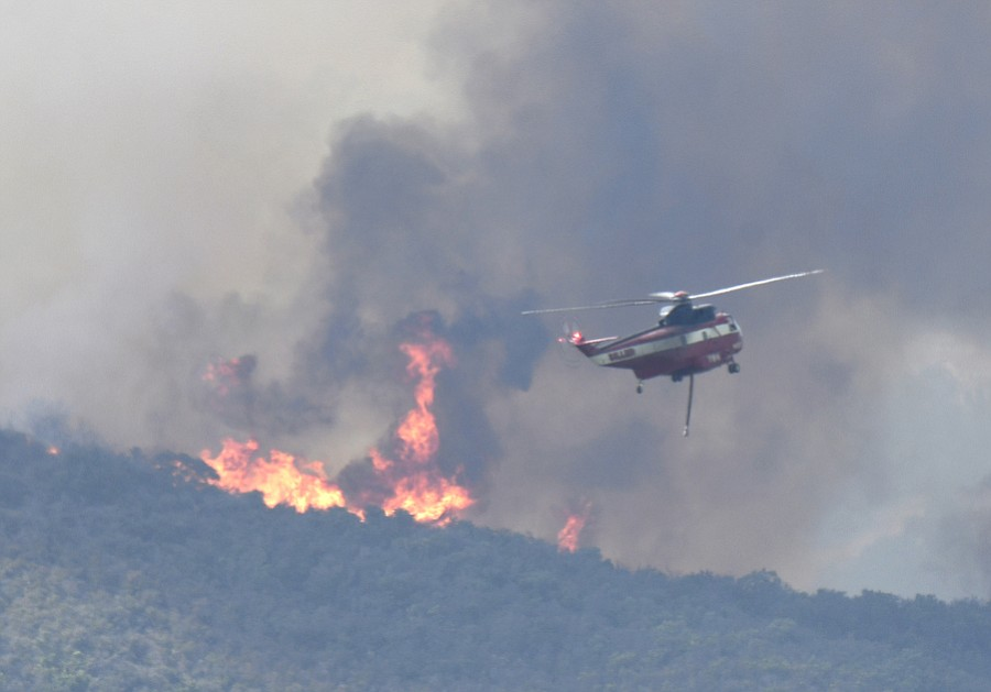 Firefighting helicopters work the Whittier Fire Sunday July 9, 2017