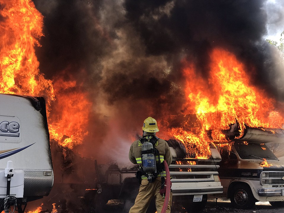 Three recreational vehicles became engulfed in flame Tuesday afternoon in an auto repair mishap.