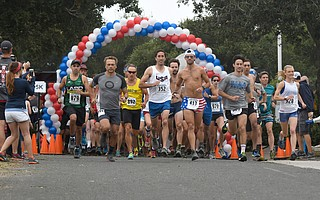 Runners at the start of the Semana Nautica 15K include the winners Addi Zerrenner (928), far right, and Sergey Sushchikh, fifth from right in the UCLA shirt.