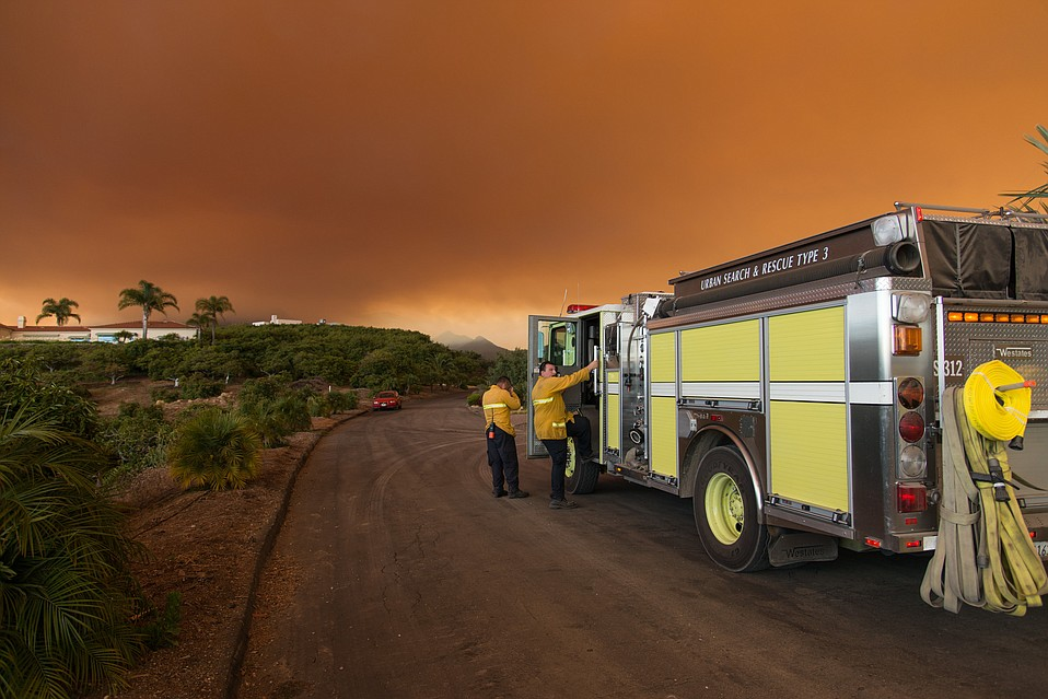 Firefighters prepare to defend homes and structures in El Capitan Ranch.