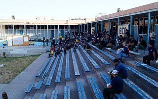 Incident commanders and their teams gather at Dos Pueblos High School, the site of incident command for the Whittier Fire, to go over Thursday evening's briefing.