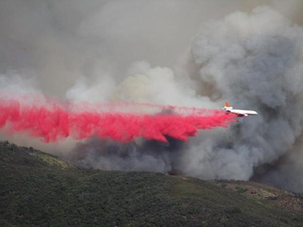 Strategic retardant drops from air tankers all day Saturday helped keep the Whittier Fire up in the mountains.