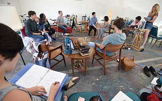 <em>AT THE TABLE</em>:  In rehearsal with Kate Bergstrom (far right)