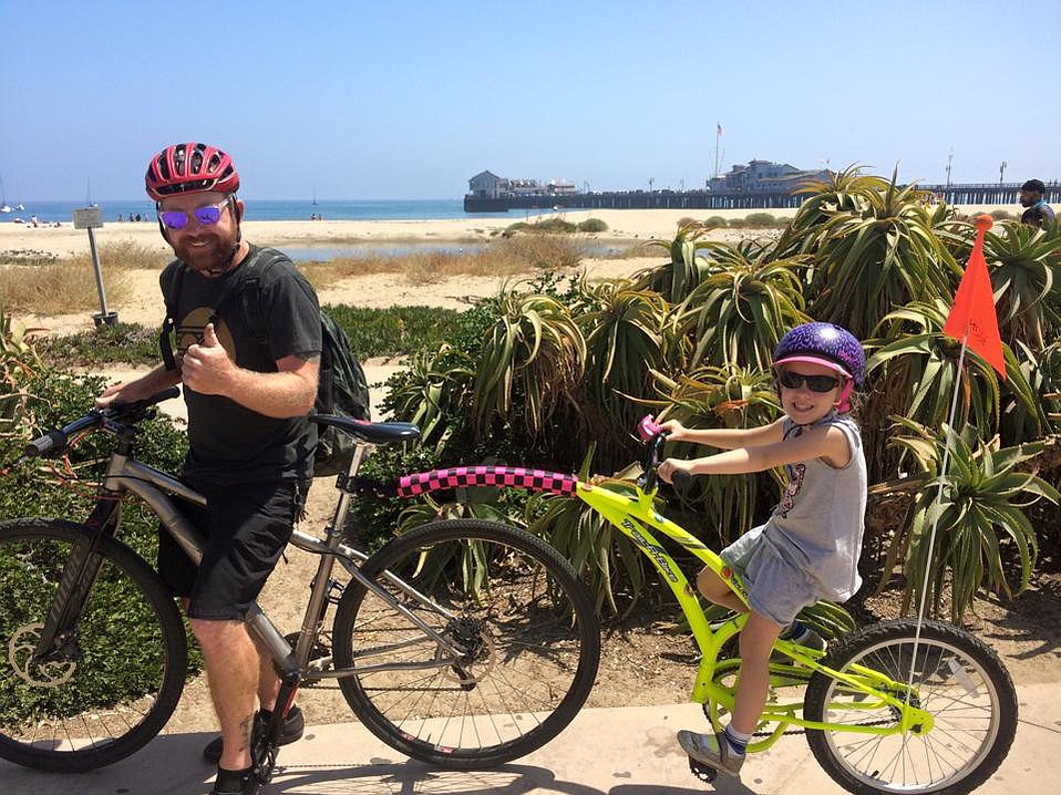 Jim Cadenhead and daughter Esther enjoy a bike ride along the waterfront.