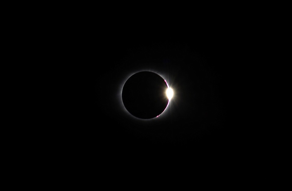 As the moon moved past the sun on its way out of totality, the moon's rugged topography allowed beads of sunlight to shine bright, an effect known as Baily's beads.