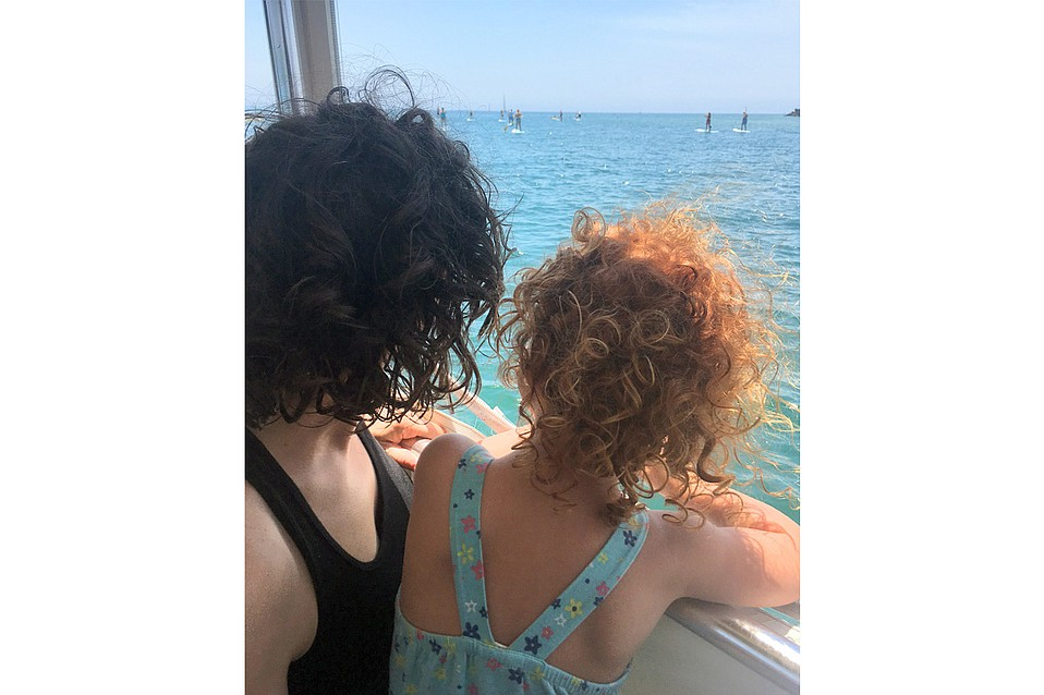 Author Talya Meyers (left), with daughter Jordan, aboard Lil' Toot