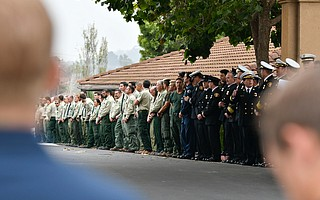 Fire service members stand at attention waiting for the remains of US Forest Service Battalion Chief Gary Helming, at the funeral service, at Pacific Christian Center in Santa Maria.