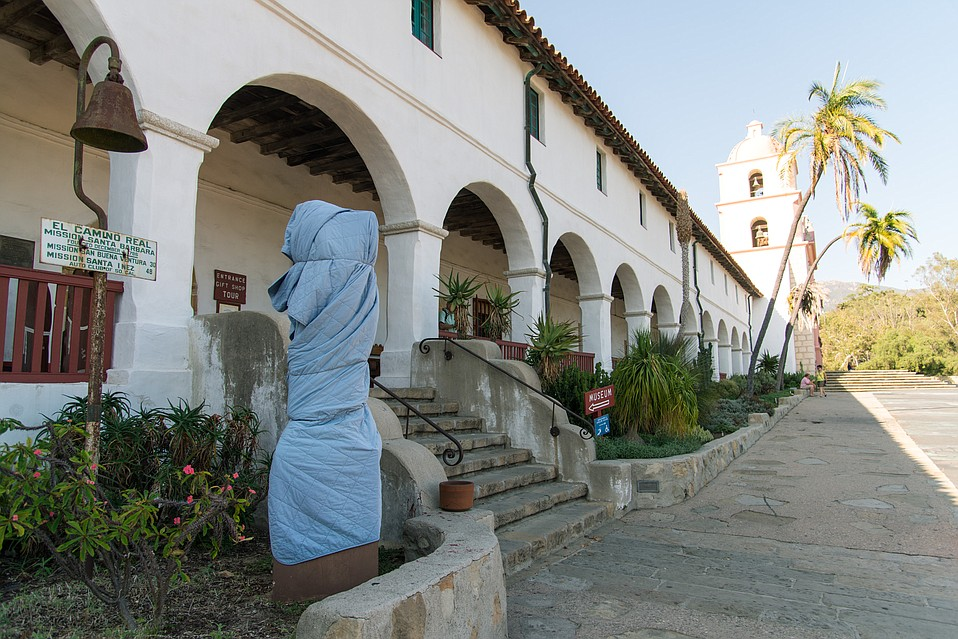 The statue of Padre Junipero Serra at the Old Mission was covered to shield it from view after vandals removed its head.