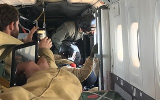 Smokejumpers from the U.S. Forest Service prepare to deploy.