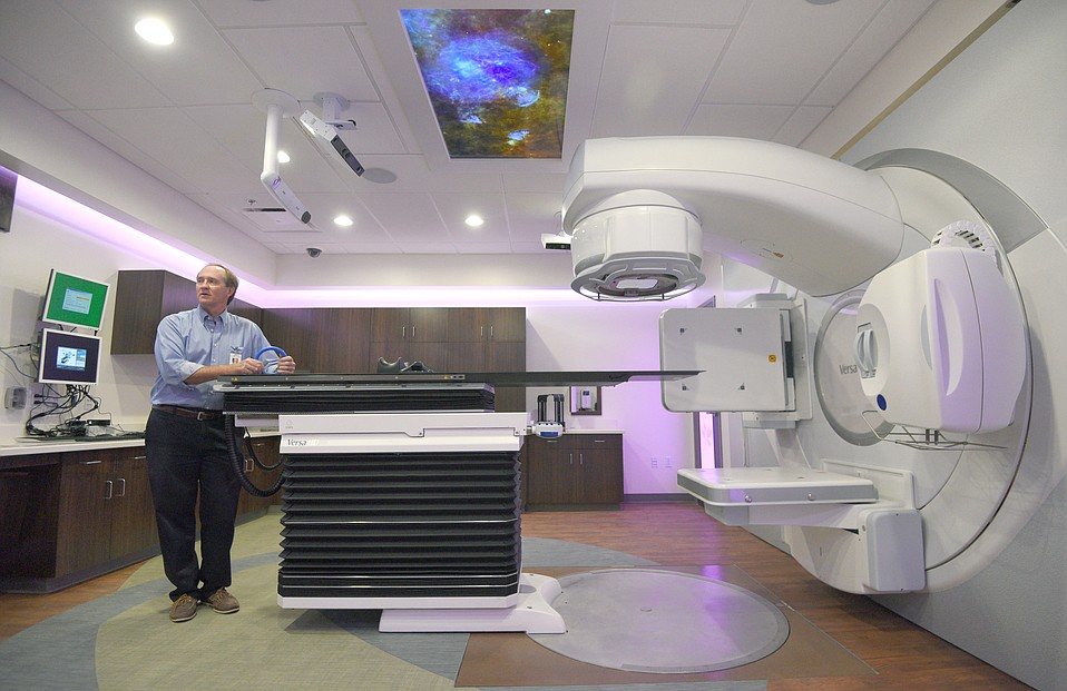 Rick Scott, president of the Cancer Foundation of Santa Barbara, shows off one of the facility's new radiation machines.