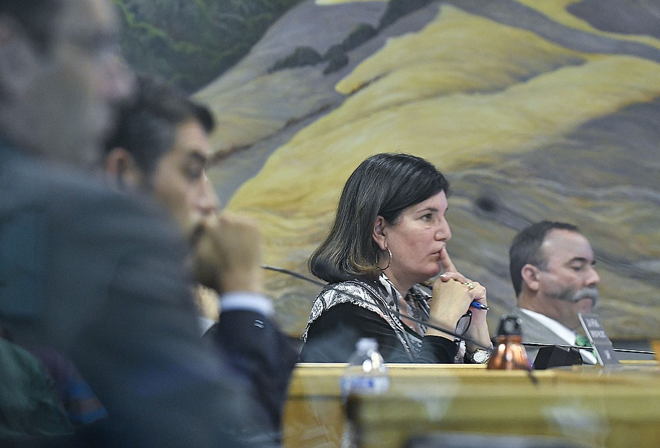 County Supervisor Janet Wolf (flanked by Das Williams, left, and Peter Adam, right) repeatedly pushed for larger buffer spaces between new recreational pot businesses.