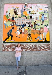Ruth Ellen Hoag with her funk zone mural.