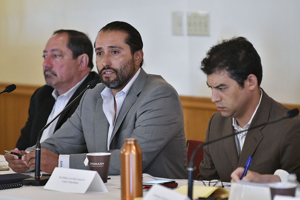 Tribal Chair Kenneth Kahn (center) speaks during a county–Chumash meeting while attorney Sam Cohen (left) and 1st District Supervisor Das Williams listen on.