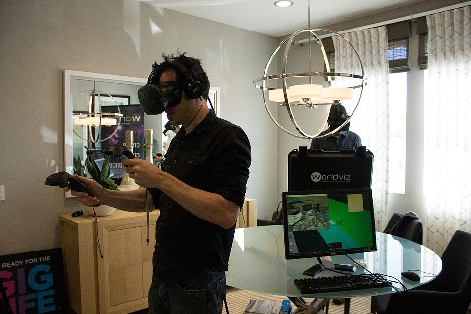 Santa Barbara's WorldViz shows off their virtual reality headsets inside a model home at Village at Los Carneros.