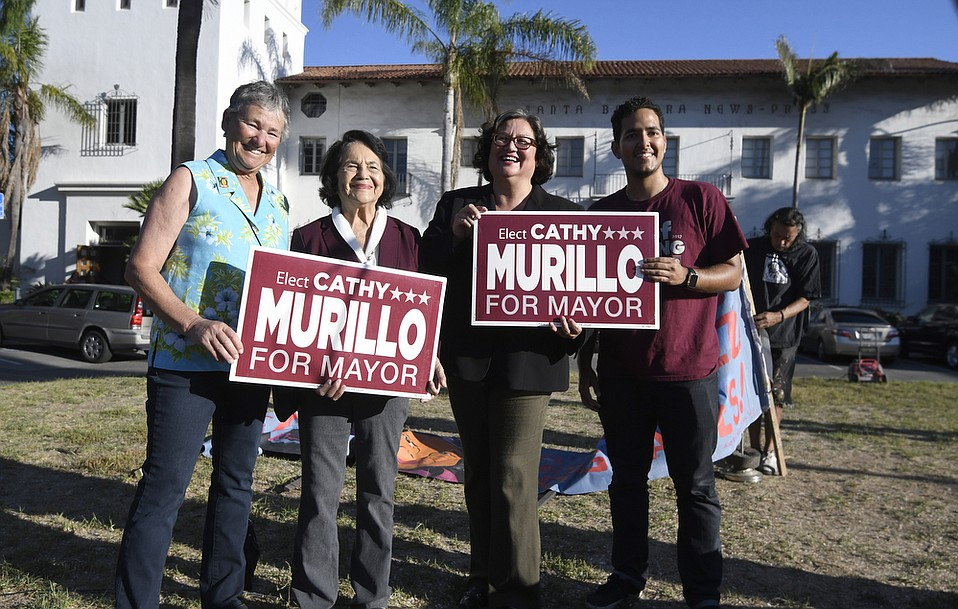 Mayoral candidate Cathy Murillo gets support from iconic labor leader and civil rights activist Dolores Huerta and a couple others at an October 27 rally before City Hall.