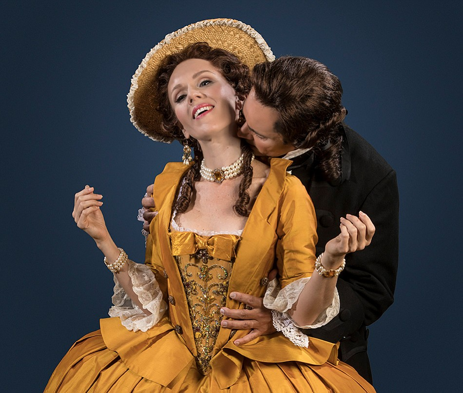 Sarah Coburn as Manon receives affection from Harold Meers as des Grieux in OSB's Manon.