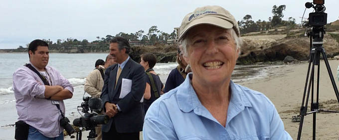 Gail Osherenko with members of the media waiting for the release of rehabilitated pelicans at Goleta Beach.
