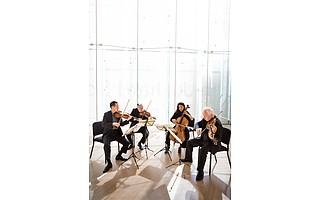 The current Juilliard String Quartet consists of (from left) Joseph Lin, Ronald Copes, Astrid Schween, and Roger Tapping.