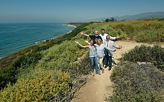 Clockwise from top left, artist Arturo Tello, the Land Trust's Chet Work, Carpinteria City Councilmember Wade Nomura, and the Land Trust's Carrie Mullen and Jennifer Stroh, after announcing the purchase of 21 acres of Carpinteria Bluffs to be turned over to Carpinteria as a public open space and nature preserve.