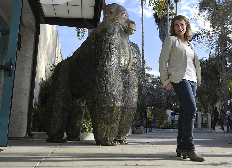Sarah York Rubin, executive director of the Santa Barbara County Office of Arts & Culture, poses with the golden gorilla statue by Morris B. Squire at the Santa Barbara Zoo.