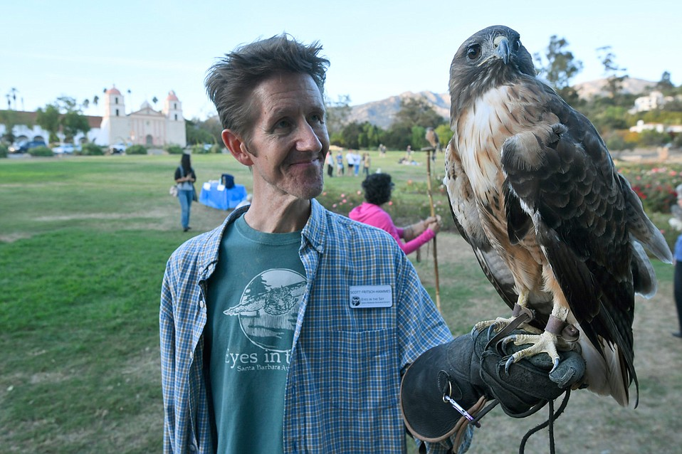 Scott Fritsch-Hammes with Ivan, the red-tailed hawk
