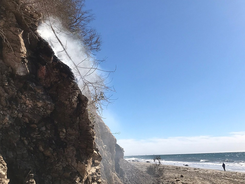 Shale oil smolders on the cliff above Hendry's Beach, where Santa Barbara County Fire was on-scene of the naturally occurring phenomena.