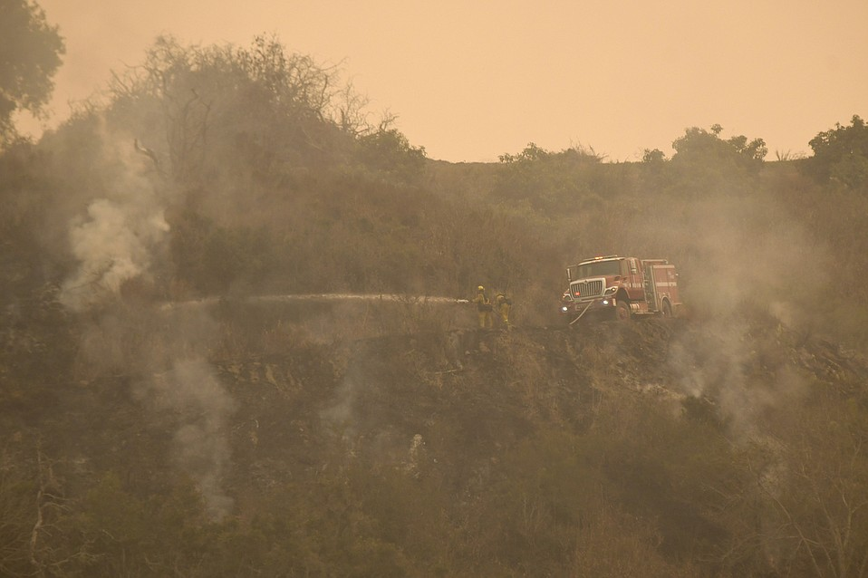 Dozers cut line to contain the Thomas Fire on Thursday, December 7.