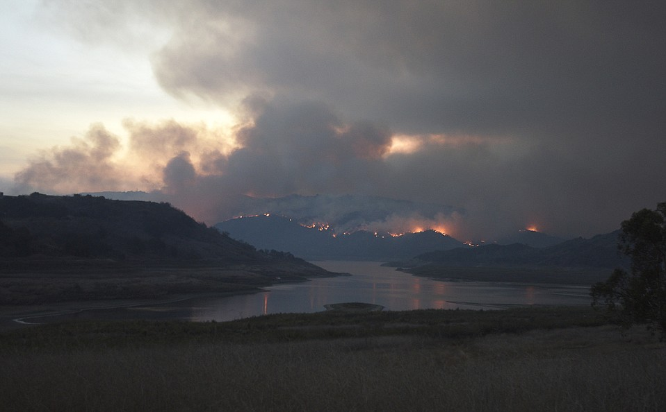 A view of the north side of Lake Casitas during the Thomas Fire, facing south (Dec. 7, 2017).