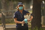 Nurse Practitioner Samvada Hillow with the Santa Barbara County Medical Reserve Corp distributes N95 masks available to the public through a partnership with Direct Relief at the Franklin Community Center. (Dec. 8, 2017)