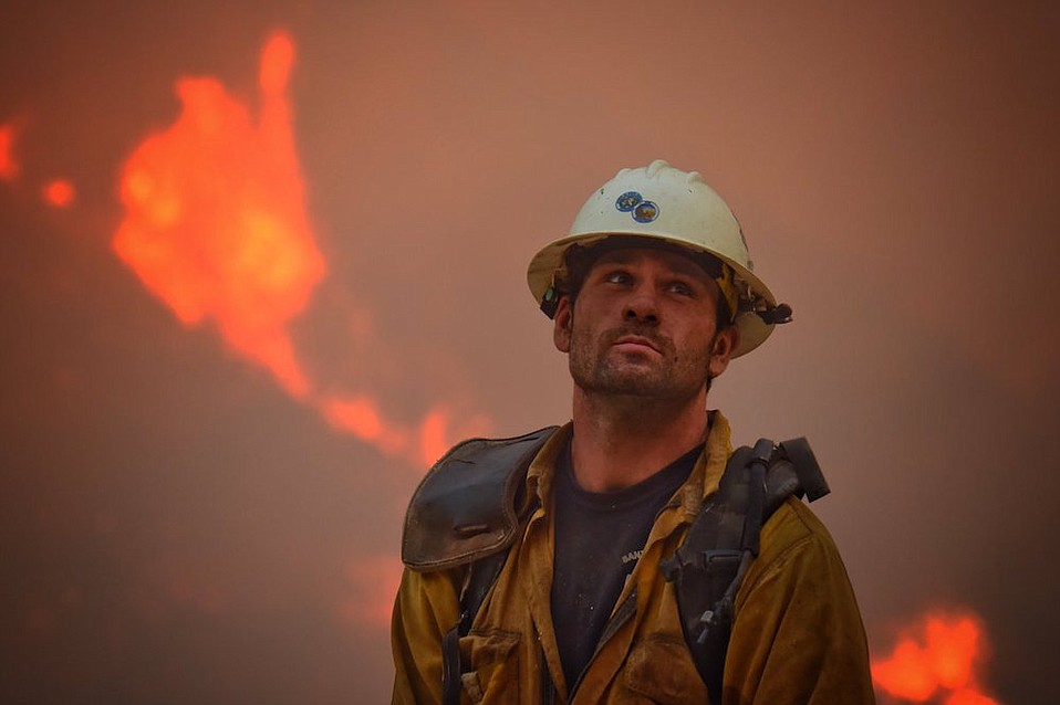 A slight lull in the Thomas Fire on Monday allowed fire crews — here Santa Barbara hand crewmember Nikolas Abele keeps an eye on a hillside for stray embers — to set backfires along Carpinteria's foothills. Containment grew to 20 percent.