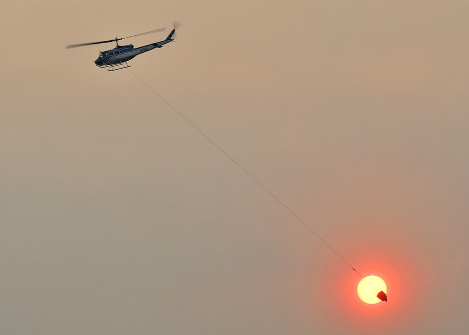 Water dropping helicopters fight the Thomas Fire in Toro Canyon Tuesday. (Dec. 12, 2017)