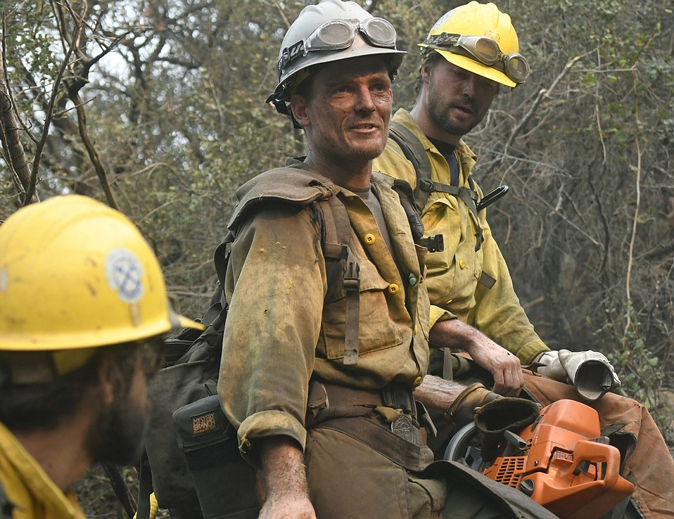 Cooper Boneck (center), one of two Arroyo Grande Hotshots working to cut a fire break up steep terrain in Toro Canyon along side members of Bend Oregon City firefighters, Santa Lucia Crew Seven and Vandenberg Hotshots. (Dec. 12, 2017)